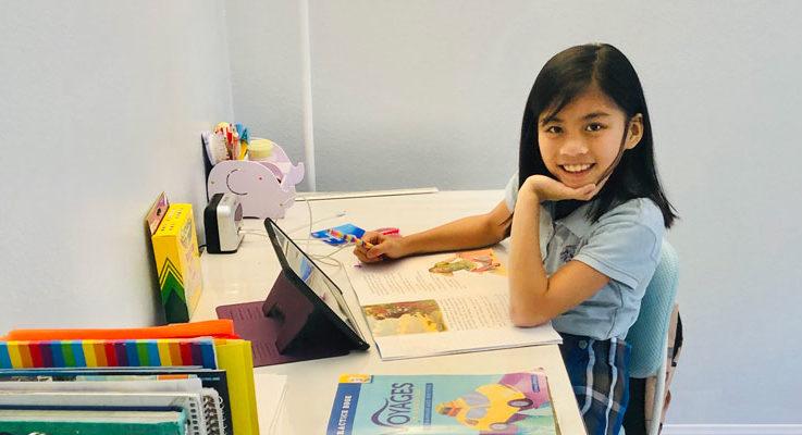 Slider – Student at Desk