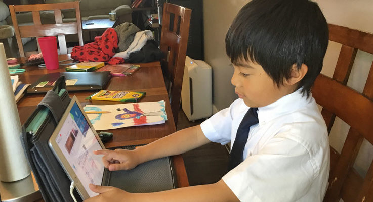 Slider – Student With iPad